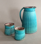 Fluted turquoise pitcher and cups